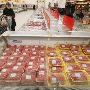 A customer visits the meat department of an Auchan hypermarket in Moscow